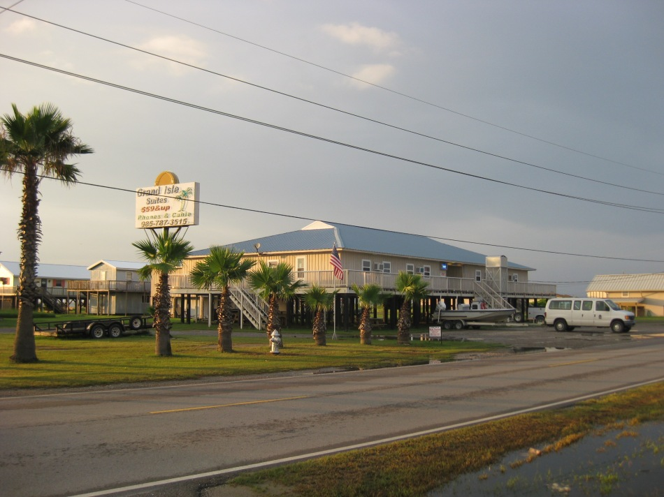 The quaint Grand Isle Suites where we stayed overnight. Our LSU van and 19' whaler are visible in front.
